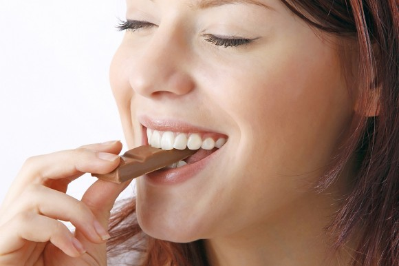 young beautiful woman with a bar of chocolate