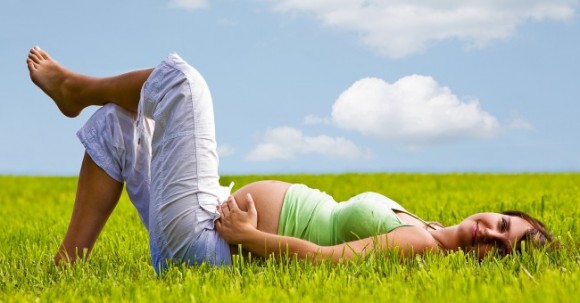 pregnant_woman_meadow_summer_laying_nature_0
