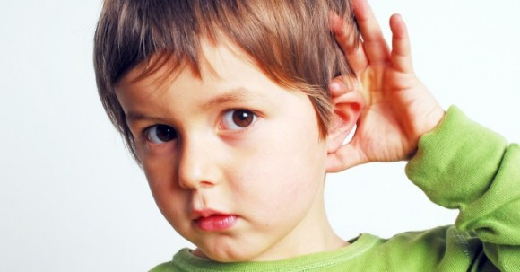 child_listening_ear_hear_learning