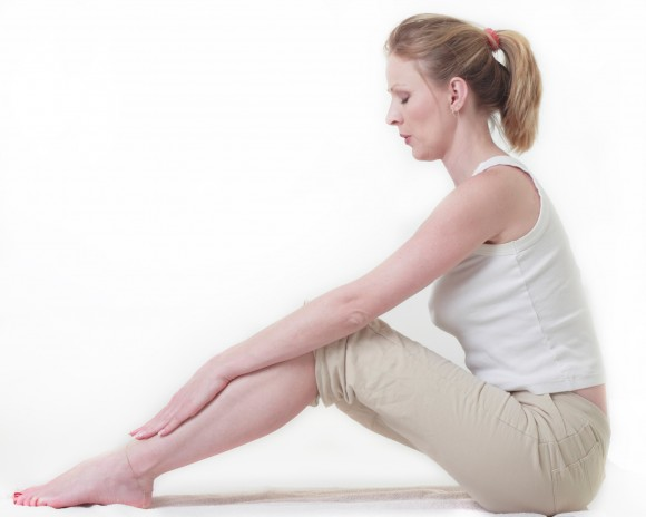 woman sitting on the floor doing a stretch