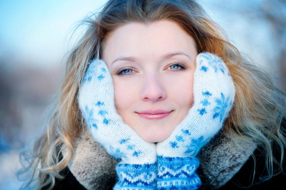 Closeup portrait of beautiful young girl in winter day